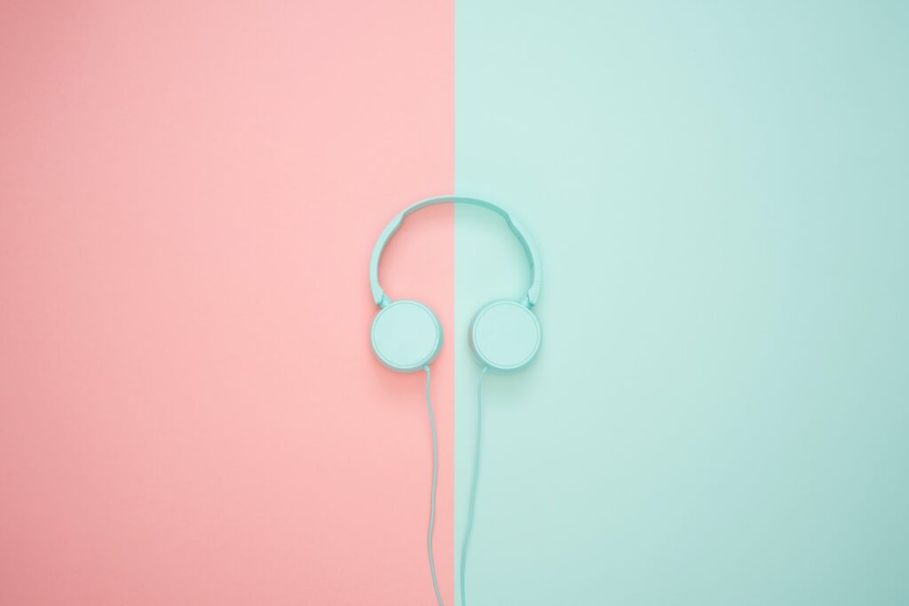 mint colored head phones on pink and mint background